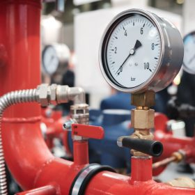 Close Up Of Manometer, Pipe, Flow Meter, Water Pumps And Valves