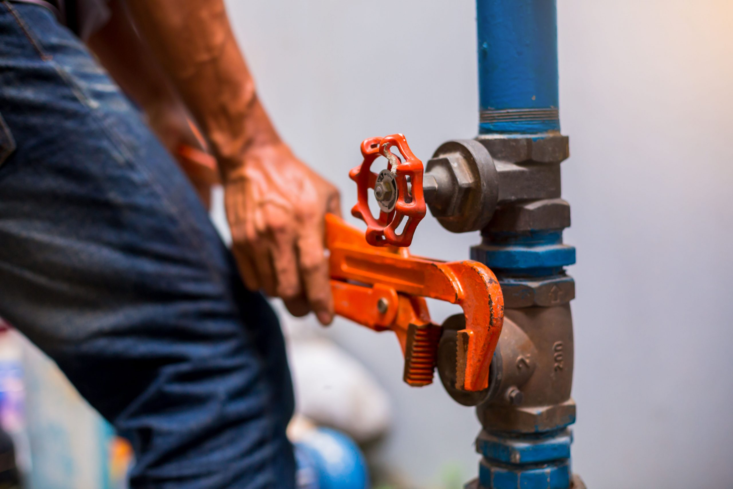 Plumber Using A Wrench To Repair And Remove The Water Supply Pip