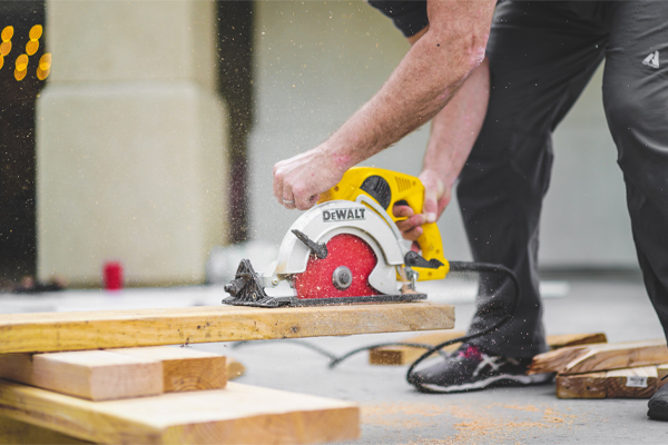 Reinstatement Contractors Cutting Wood To Restore Office Space